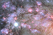 A Cauldron of Star Birth in the Center of a Young Galaxy