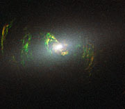 Hubble view of green filament in galaxy NGC 5252