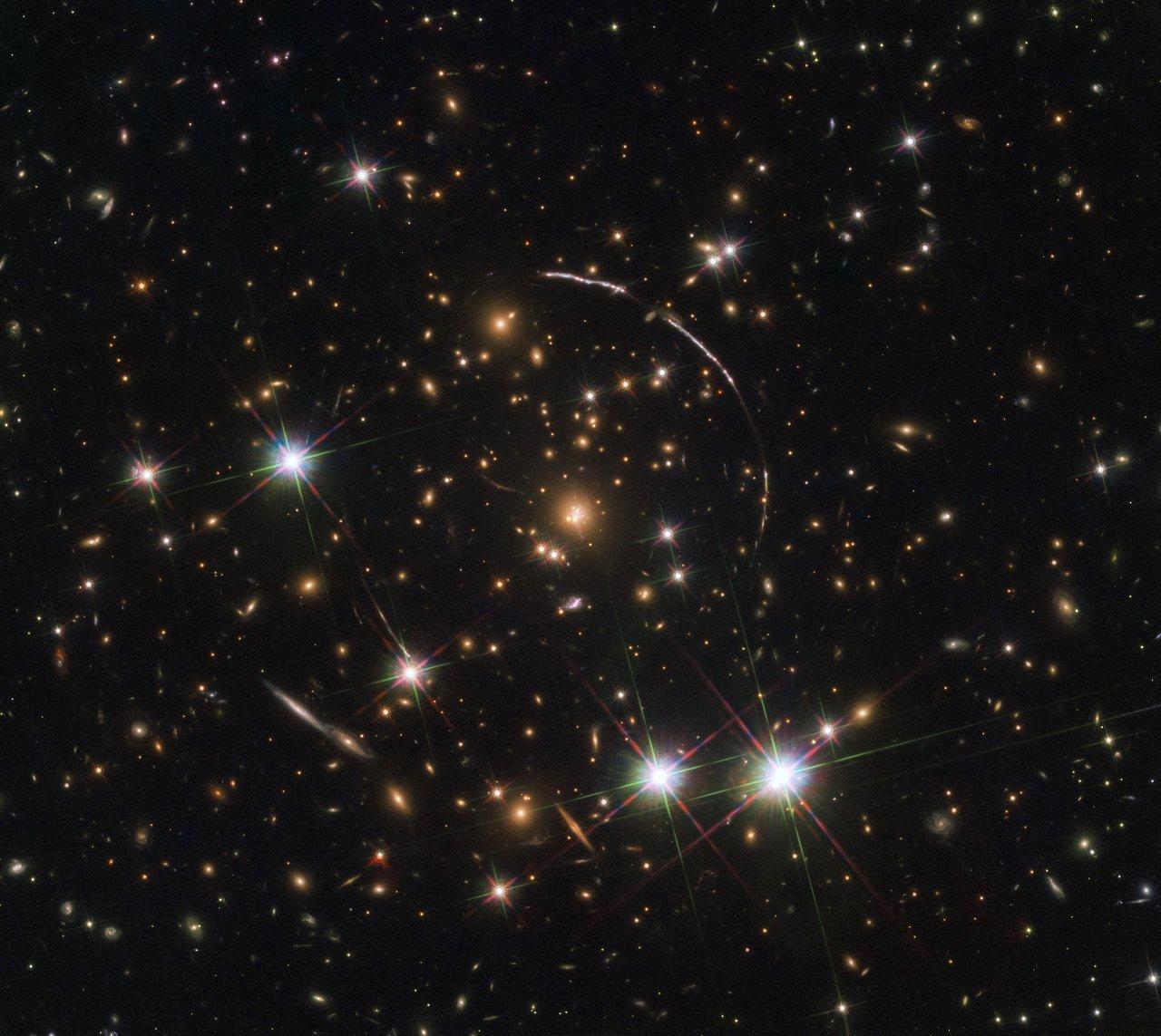 Hubble Captures a Dozen Sunburst Arc Doppelgangers