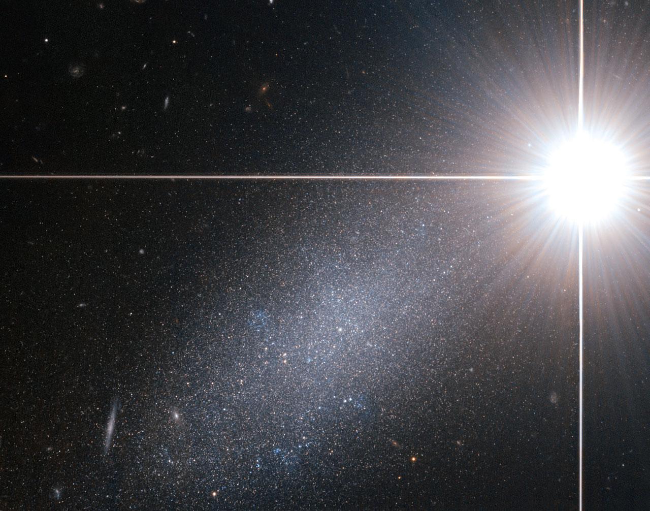 Bright star — faint galaxy