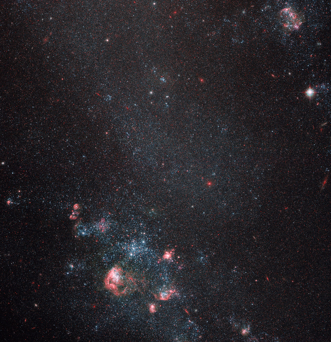 Faint galaxy with popping pink features