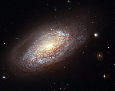 Galaxy NGC 2397 with an explosive secret