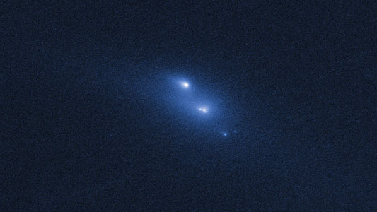 Disintegrating asteroid P/2013 R3 as viewed by Hubble on 29 October 2013