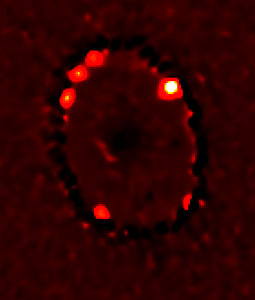 Four Bright Knots of Superheated Gas in Supernova 1987A Ring