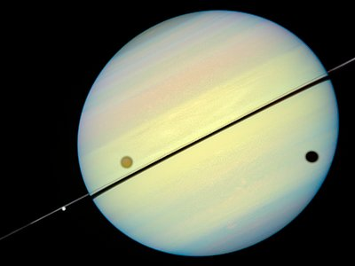 Hubble Catches Titan Chasing Its Shadow - Frame 1