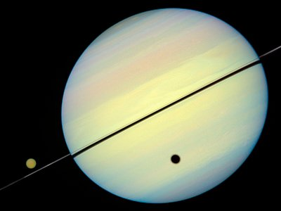 Hubble Catches Titan Chasing Its Shadow - Frame 3