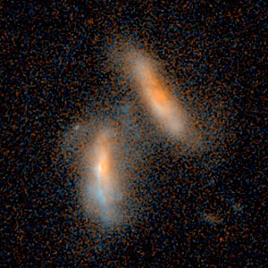 Merging galaxies — 2.4 billion light-years from Earth