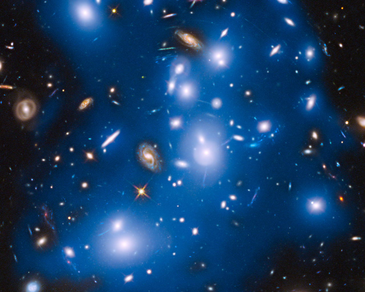 Hubble sees ghost light from dead galaxies in galaxy ...