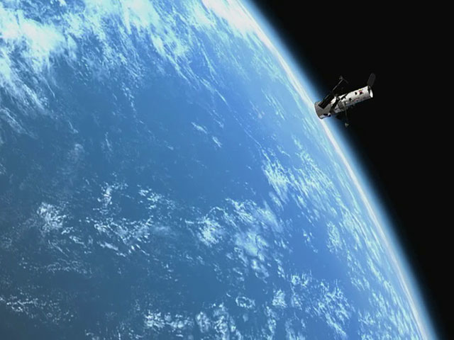 The NASA/ESA Hubble Space Telescope over the Earth, passing slowly