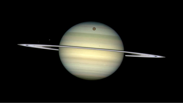 Four of Saturn's moons parade by their parent (artist's impression)