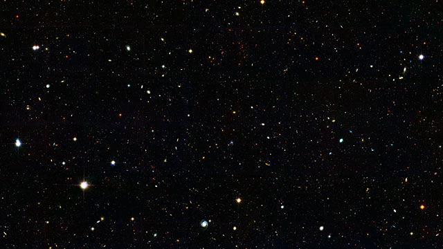 Zoom into a distant galaxy core in the Hubble GOODS North field