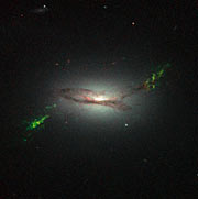Hubble view of green filament in galaxy 2MASX J22014163+1151237