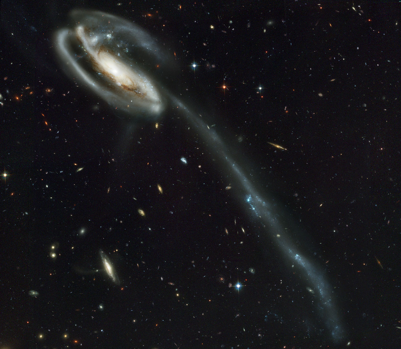 A Wallpaper Of Distant Galaxies Is A Stunning Backdrop For