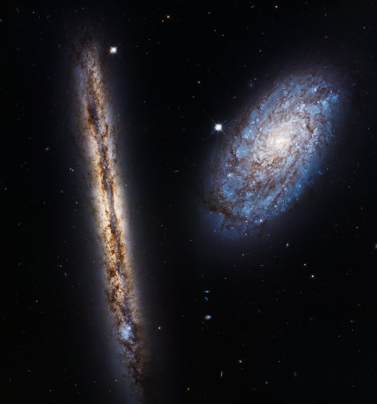 Photo Release: Hubble celebrates 27 years with two close friends