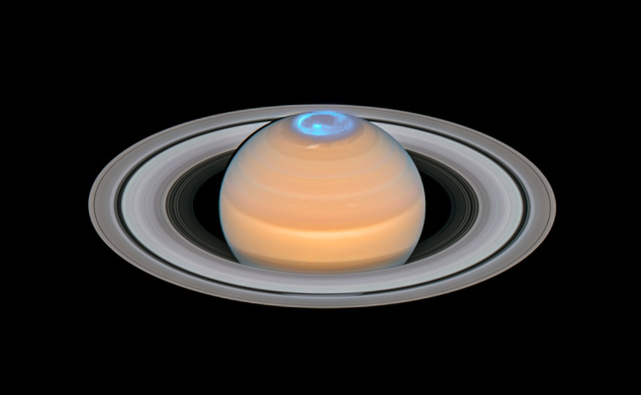 Saturn and its northern auroras (composite image)