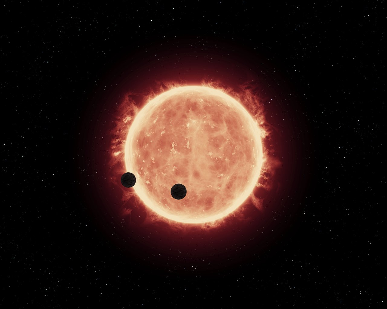 Artist's view of planets transiting red dwarf star in TRAPPIST-1 system