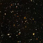 "Spitzer and Hubble team up to find ""Big Baby"" galaxy in the newborn Universe [ACS image]"