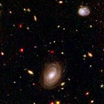 "Spitzer and Hubble team up to find ""Big Baby"" galaxy in the newborn Universe [NICMOS view]"