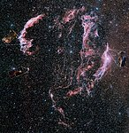 Wide-field ground-based astrophoto of the Veil Nebula, annotated