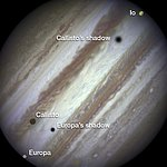 Three moons and their shadows parade across Jupiter — end of event, annotated