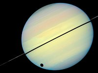 Hubble Catches Titan Chasing Its Shadow - Frame 2