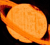 Discovery of a Dark Auroral Oval on Saturn