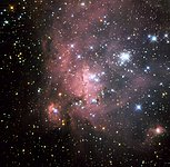 Probing a super-giant shell of gas and stars