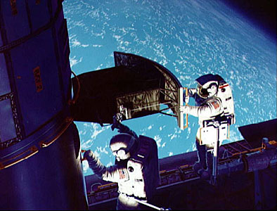 SM1: Artist Rendition of Astronauts on the Job