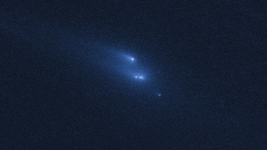 Disintegrating asteroid P/2013 R3 as viewed by Hubble on 15 November 2013