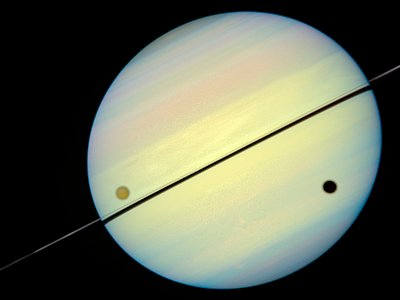 Hubble Catches Titan Chasing Its Shadow - Frame 4