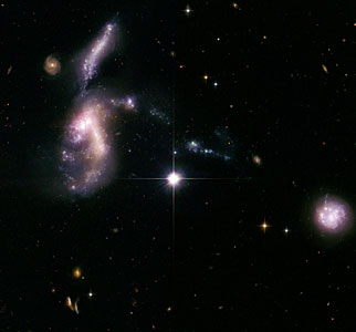 Hickson Compact Group 31: interacting galaxies glow with millions of young stars