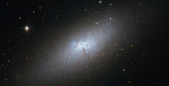 A Peculiar Compact Blue Dwarf Galaxy