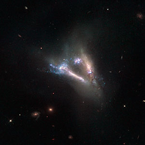 "Cosmic ""flying V"" of merging galaxies"