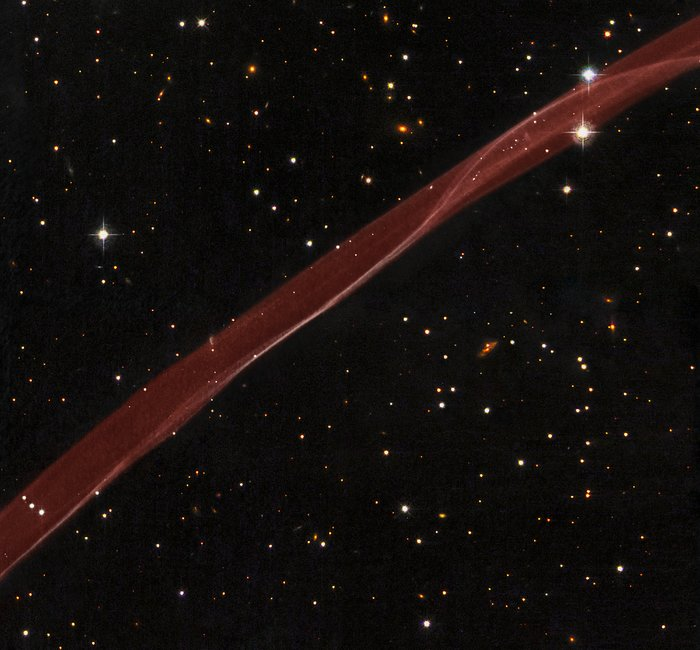 Hubble sees stars and a stripe in celestial fireworks