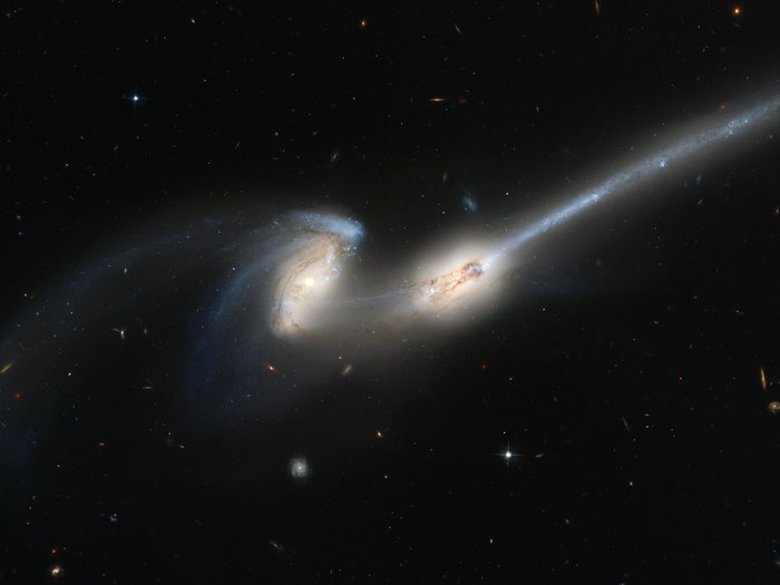 Hubble's newest camera takes a deep look at two merging galaxies