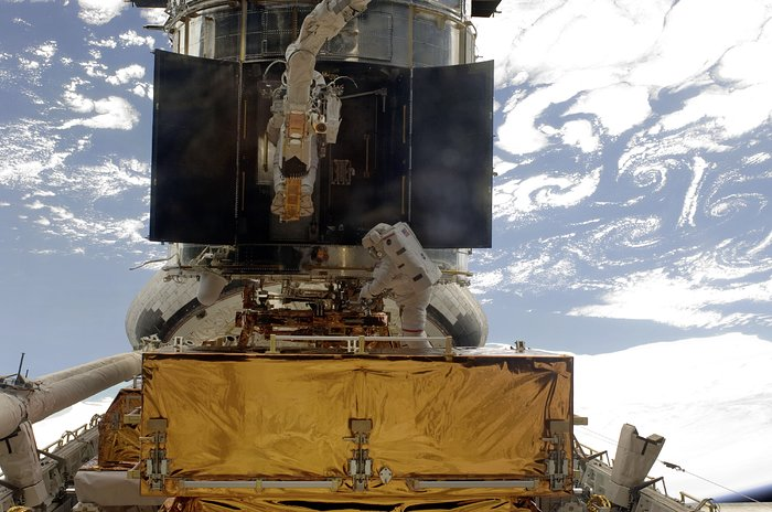 Astronauts at work on Hubble