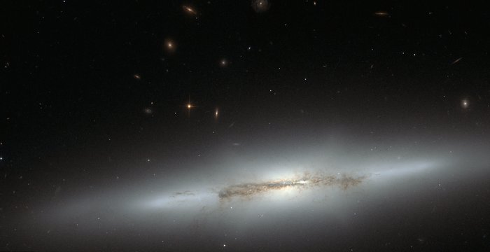 Hubble looks at sideways NGC 4710 (full)