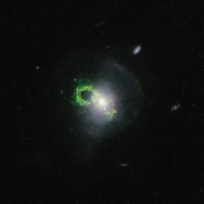 Hubble view of green filament in Teacup galaxy
