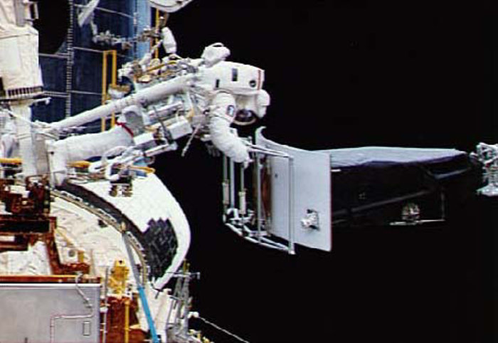 Astronaut Servicing the Hubble Space Telescope