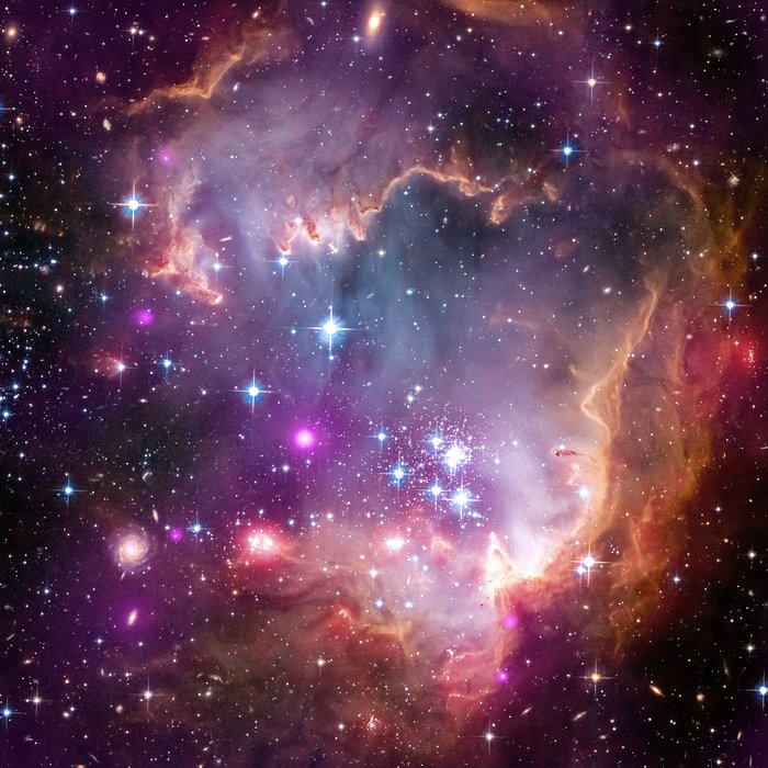 "Hubble/Chandra/Spitzer composite image of NGC 602, in the ""wing"" of the Small Magellanic Cloud"