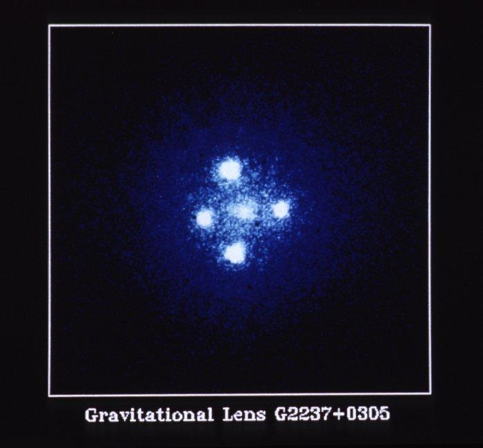 The Gravitational Lens G2237 + 0305