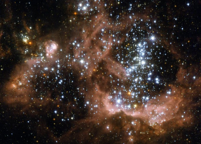 Young stars biting the cloud that feeds them