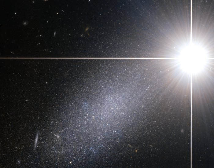 Bright star — faint galaxy