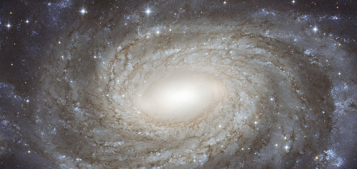 Perfect spiral overlaid with Milky Way gems