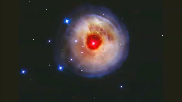 Hubble watches light echo from mysterious erupting star