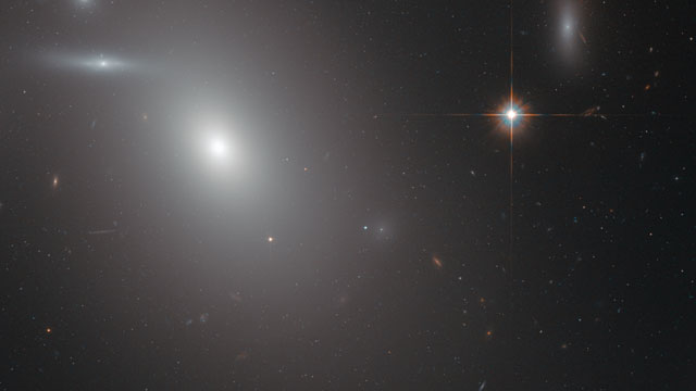 Panning across the elliptical galaxy NGC 4889
