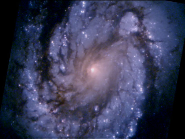 This comparison image of the core of the galaxy M100 shows the dramatic improvement in Hubble Space Telescope's view of the universe.